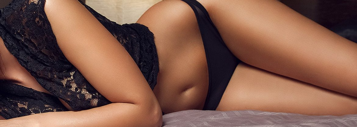 asian masseuse in marylebone london lay on bed in lingerie