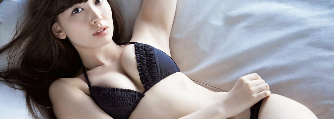 cute asian masseuse on bed in knightsbridge for incall body massage